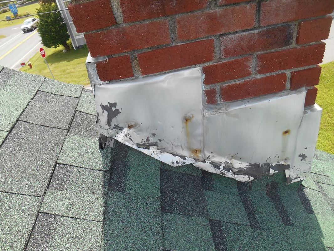 Bad Flashing Around Chimney Causing a Leak Richmond Virginia Roofing